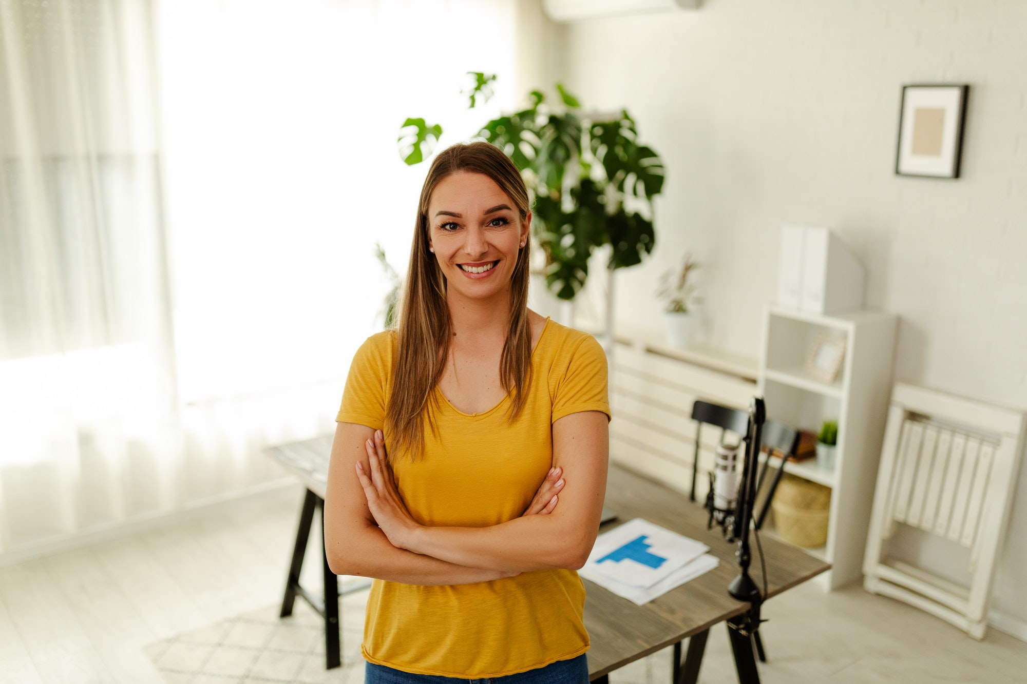 Portrait of a female online store business owner looking at camera and smiling.